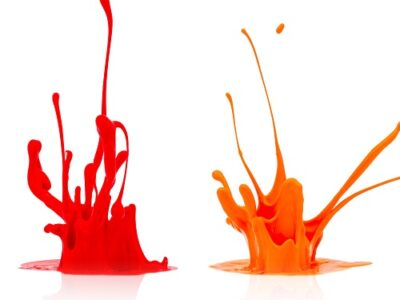 A line of colorful paint splashes on white background. Taken in Studio with a 5D mark III.